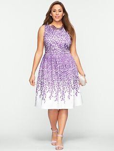 I bought this in the lavender to wear to my brother's wedding.  Leaf-Print  Dress -- Talbots
