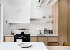 Folk Architects welcome us inside their Storybook House; a dynamic alteration and addition onto a double-fronted Melbourne terrace. Stone Kitchen Island, Kitchen Island Bench, Kitchens And Bedrooms, Home Kitchens, Custom Dining Tables, Freestanding Fireplace, Interior Desing, Tadelakt, The Design Files