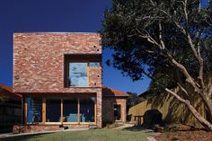 The Ilma Grove house is Austin Maynard Architect's greenest house (so far). Its planning and orientation is based solidly around passive solar efficiency. It has solar pane. Brick Masonry, Brick Facade, Build Your House, Building A House, Barrow House, Recycled Brick, Brick Architecture, Australian Homes, House Extensions