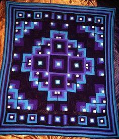 Multicoloured crochet blanket.
