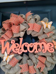 Coral/orange burlap Welcome wreath accented with chevron ribbon and burlap butterflies. on Etsy, $55.00