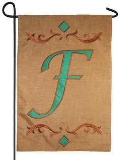 "Decorative burlap garden flag, featuring an elegantly designed, bright teal colored monogram letter """"F"""" appliqued onto a textured polyester material that looks and feels like real burlap. The letter"