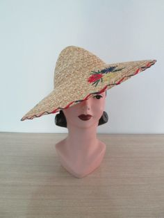 Stunning Vintage 1940s 40s 1950s 50s Large Straw Summer Sun Hat with Raffia Flowers -Deadstock/Nos- French Riviera-Pinup-Bombshell-Vixen by dixiefried on Etsy https://www.etsy.com/ca/listing/198402732/stunning-vintage-1940s-40s-1950s-50s