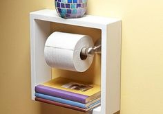 toilet_paper Buy a floating square shelf (see image) and hang it around your toilet paper holder. This design will give you two extra shelves to stock small items, such as books and decorations. You can also create a DIY toilet paper holder to hang extra rolls. Check out the tutorial here.