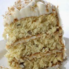 Decadent Italian Cream Cake Recipe Desserts with butter, shortening, sugar, large eggs, buttermilk, vanilla, all-purpose flour, baking soda, salt, sweetened coconut flakes, chopped pecans, butter, cream cheese, vanilla, powdered sugar, chopped pecans