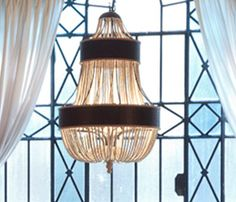 """Natural glamour!  Fabulous chandelier strung with wood beads.  It's a strong statement piece.  That statement is, """"This is a spectacular room."""" #RANaturals"""