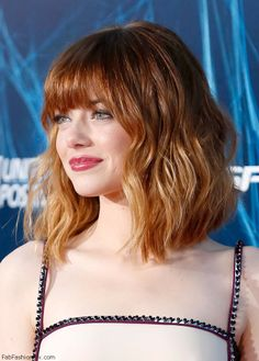 Emma Stone with fringed bangs and ombre highlights hairstyle