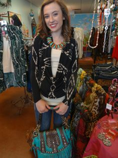 Tribal top with drape neck $32, cami $8, Skinny jeans $54, necklace/earring set $28, Purse $48