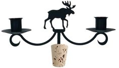A unique accessory for wine and candle lovers, this decorative Wrought Iron Wine Bottle Topper features a Moose silhouette. This candelabra holds two taper candles (not included). A great gift or centerpiece idea!