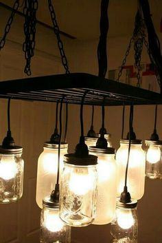 Southern Charm Mason Jar Chandelier - IKEA Hackers I don't necessarily like the pot rack part of this, but I do like these light cords. Mason Jar Chandelier, Mason Jar Lighting, Mason Jar Lamp, Diy Chandelier, Kitchen Chandelier, Homemade Chandelier, Farmhouse Chandelier, Chandelier Creative, Outdoor Chandelier