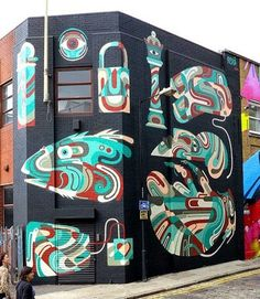 While in town for a solo show, REKA freshens up his old mural. At Whitby + Chance Streets, Shoreditch, London, UK - September, 2014 (LP)