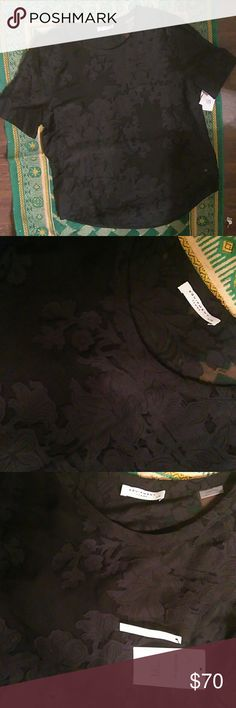 Equipment Sheer Floral Black Blouse NWT This gorgeous Equipment blouse is a size Large, and comes in a light and airy 53% cotton/47% silk blend. Black fabric featuring a floral appliqued print, perfect for spring. Never worn, tags still attached, garment in perfect condition. Equipment Tops Blouses