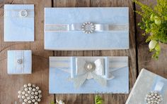 Wedding Stationery Designs Idea to make your own blue and white wedding stationery with pearls. Pretty DIY wedding stationery. Paper craft supplies from Imagine DIY