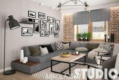 Szara sofa i czerwone cegły w skandynawskim salonie - Lovingit.pl