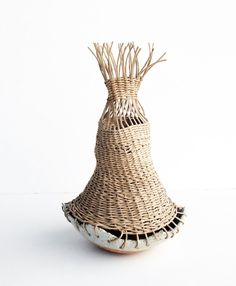 "hand made stoneware pot with crackle glaze and handwoven basket top 8"" diameter by 11"" tall cork pads on base to prevent scratching made by tw in mt washington, california basket cannot be submerged i"