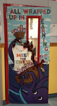 """Nautical, ship, ocean themed door/bulletin board """"All wrapped up in learning"""" on the door, """"Meet the crew"""" on the said - octopus wrapping a bow around the ship and lights added (Christmas time)"""