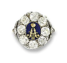 RUSSIAN DIAMOND AND ENAMEL RING The central dark blue guilloché enamel plaque with the cipher of Tsar Alexander II to the old-cut diamond surround and foliate shoulders, mounted in silver and gold, circa 1870 Victorian Jewelry, Antique Jewelry, Vintage Jewelry, Catalina La Grande, Renaissance, Monogram Jewelry, Royal Jewelry, Art Nouveau Jewelry, Crown Jewels