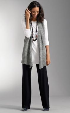 This is my go-to look: Black pants, a long sleeved shirt and a vest (or a shell and cardigan) with a cool necklace.