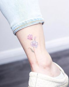 Delicate florals on ankle by Mini Lau