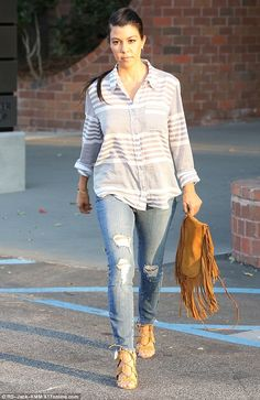 Low-key: Kourtney Kardashian, 36, concealed her figure in an uncharacteristically casual e...