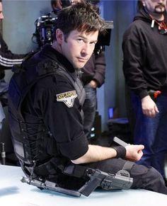 """Joe Flanigan (as John Sheppard) takes a breather during filming. Stargate Atlantis, Stargate Universe, Marvel Universe, Michael Shanks, Sci Fi Shows, Great Tv Shows, Battlestar Galactica, Favorite Tv Shows, Animal Quotes"