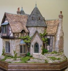 Stone dollhouse with angles and turrets