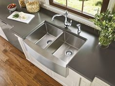 A fashion-forward stainless steel apron front sink can complete any kitchen.