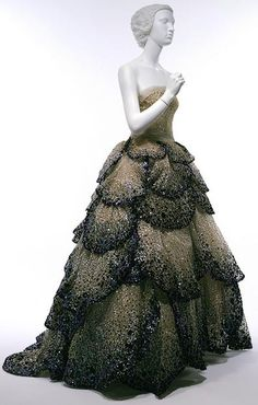 Junon Dress, Christian Dior 1947  Pale-blue silk net embroidered with iridescent blue, green, and rust sequins.  http://www.metmuseum.org/toah/works-of-art/C.I.53.40.5a-e