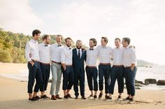 Rolled up trousers and casual lace-ups for a beach wedding