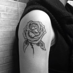 Small rose tattoo by Stoy Saketattoocrew