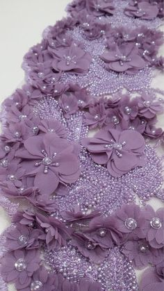 This luxury, high quality lilac lace fabric is beaded by hand. Most pearls and beads are carefully sewed by hand. Flower petals are arranged to create a beautiful design. The dress made from this material will look royally gorgeous. Tambour Beading, Tambour Embroidery, Couture Embroidery, Embroidery Fashion, Ribbon Embroidery, Fabric Beads, Lace Fabric, Fabric Flowers, Hand Flowers