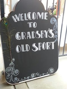 took my pop's old sign and used chalkboard paint. fit perfectly with our themed grad party.