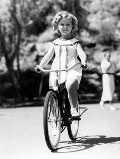 Shirley Temple after her first bicycle-riding lesson. Palm Springs, April, 1936
