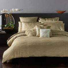 This luxurious duvet cover by Donna Karan crafted in silk jacquard features a windy striped texture reflective of soft ripples on water. | Face: polyester/rayon/silk; back: cotton | Machine wash | Imp