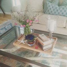 I found this lovely tray at local thrift store for $4.  Trays are a great way to showcase some of your favorite items. Books, hurricane candleholder, vase with flowers, the options are endless!