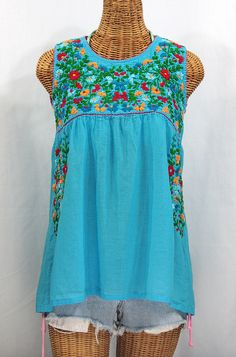 "Siren's ""La Sirena"" Sleeveless Hand-Embroidered Cotton Vintage-Mexican Style Peasant Top/blouse in Mint Green with Multi-Color Fiesta Embroidery. Hand dyed, distressed and embroidered for a vintage gypsy hippie look and feel. Peasant Blouse, Blouse Dress, Peasant Tops, Tunic Tops, Mexican Blouse, Mexican Dresses, Mexican Clothing, Hippie Look, Bohemian Look"