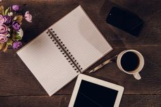 Top view hot coffee and note book by Pushish Images on @creativemarket