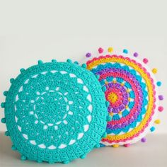 Learn how to crochet pom poms and add them to these pretty crochet mandala pillows. Pattern included