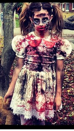 Zombie costume from a thrifted dress and lots of fake blood. So easy!