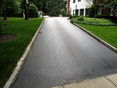 Edge the Driveway: Installing a border along the driveway gives it a crisp, elegant look. Edging materials such as bricks, pavers, and stone, or a combination of them, bring a boring asphalt slab to life with color, texture, and decorative designs. The edging can be level with the driveway or elevated to prevent people from driving onto your lawn.