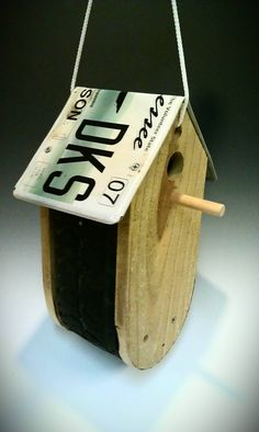 Birdhouse made from tire tread and car tag license plate