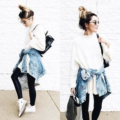 Pin for Later: 32 Lazy but Stylish Outfit Ideas For the Days You Just Don't Feel Like Trying An Oversized Cream Jumper, Black Leggings, White Trainers, and a Denim Jacket Tied Around the Waist