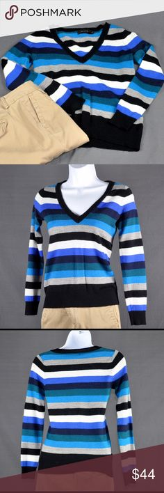 "The Limited Blue Stripe V-Neck Sweater Top Top is in excellent pre-loved condition. Perfect for work, with a tank underneath. Lightweight fabric great for warmer weather. 50% merino wool, 50% acrylic. Measured flat: bust: 16"", length: 22"", sleeve length: 22"". Smoke free pet friendly home. The Limited Sweaters V-Necks"
