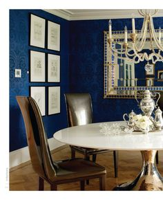 Navy blue and bronze chairs. The rich wallpaper is beautiful!