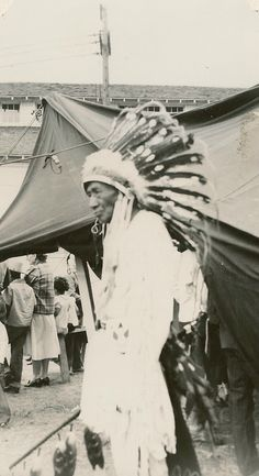 The Blackfoot Idaho Fair.  This fair was just one of many lucrative fairs that the Siebrand Bros played.The Chief in this photo, along with many other Native American people played a very important part with their dancing and singing.  In a special area they had an Indian Village where one could buy hand made goods. This photo taken in 1951.