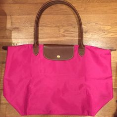 Large - Longchamp Le Pliage Tote Longchamp Le Pliage large tote almost brand new. I only used it two times! Perfect for the Spring and upcoming Summer. Longchamp Bags Totes