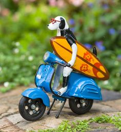 Surfer Dog on his scooter heads to the beach to hang ten. Let this freewheeling pet kick start your garden decor! It makes a delightfully unexpected accent to flower bed, large planter or even indoors. Recycled Metal Art, Fairy Village, Large Planters, Hang Ten, Wind Spinners, Garden Statues, Yard Art, Pets, Animals