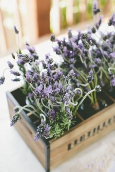 Use little lavender bunch bouquets from the bridal party and put them in mason jars and crates to decorate your tables