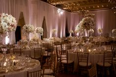 Wedding Reception- Montage in Beverly Hills, tall centerpieces, white flowers, white drapes, candles www.aboutdetailsdetails.com