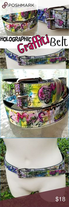 """Punk Artsy Graffiti Belt For the girl who loves punk, emo, rocker, unique, artsy things!  Funky Graffiti Belt With Pink Rhinestone Buckle Size Medium  Holographic effect - changes designs as you move!   Lots of various text / graffiti words: """"Peace"""" """"Love"""" """"OMG"""" """"This way"""" """"Lucky 8"""" """"L8tr"""" """"Koi"""" """"ping"""" """"RockStar""""    Belt measures 1 and 3/8"""" wide. Waist on smallest setting 31"""". On largest setting 35.5"""". Hot Topic Accessories Belts"""